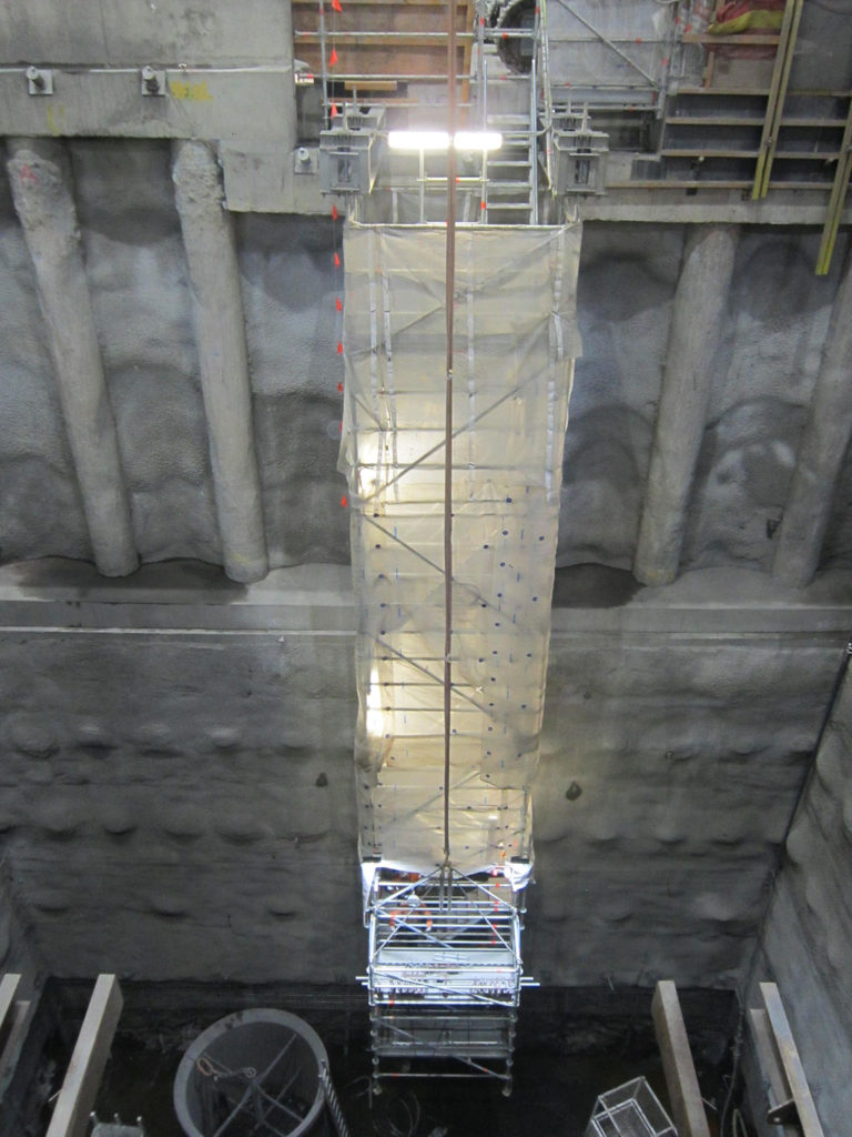 A module of the suspended stair tower is lowered into position