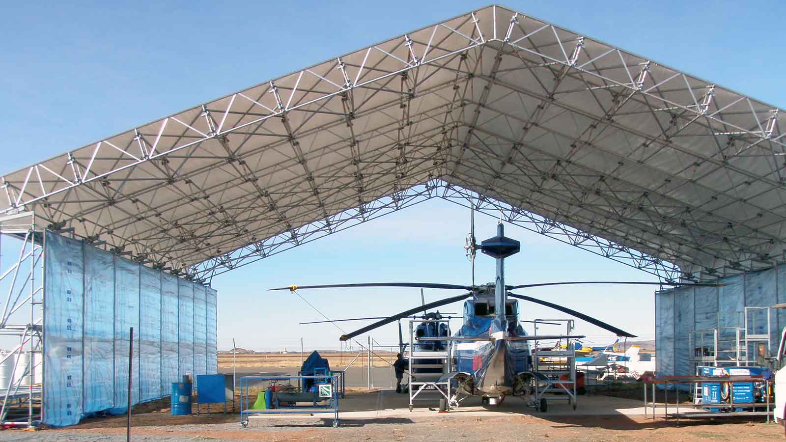 Helicopter hangar (temporary maintenance shelter) constructed using Layher Keder Roof system