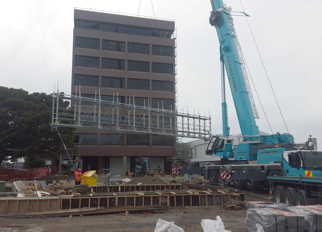 Layher Allround Bridging System being craned into position on top of heavy duty scaffold columns