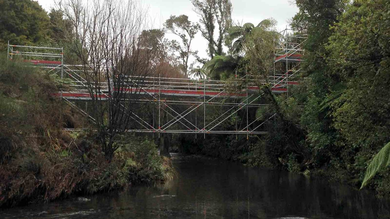 Temporary bridge, made from Layher scaffolding, for pipe maintenance over Patea River by Clearway Scaffolding