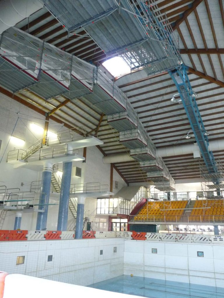 Maintenance scaffolding spans over swimming pool
