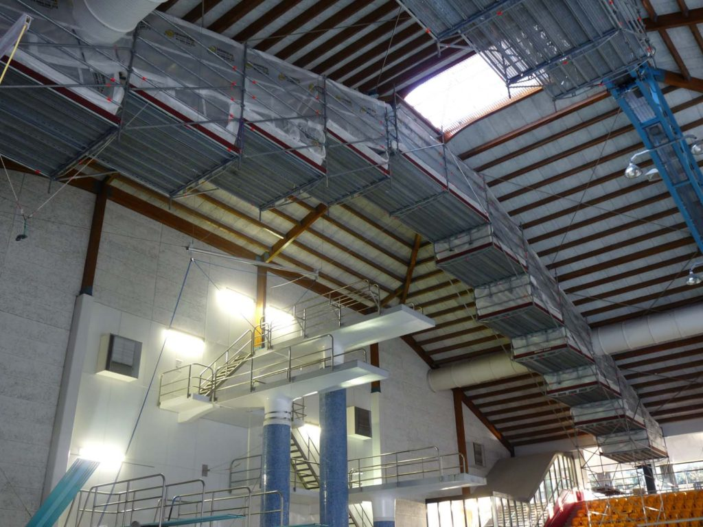 Scaffolding providing access to roof trusses over swimming pool